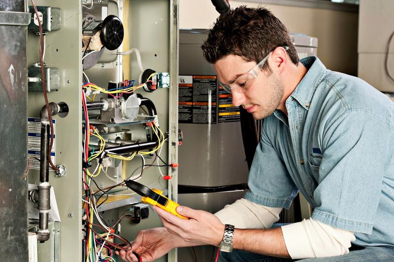 service-technician-testing-furnace