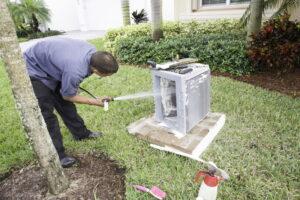 AC-technician-cleaning-unit